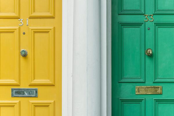 Two different coloured doors to highlight the differences between copywriting and content marketing