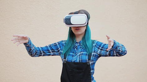 A women engaging with virtual reality headset