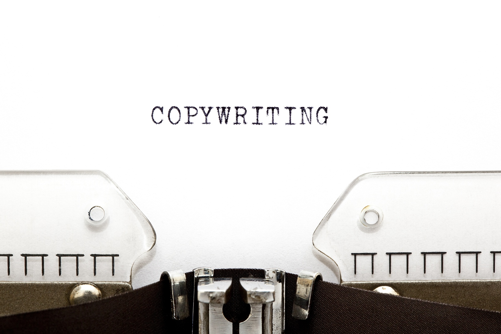 A type writer writing the word copywriting